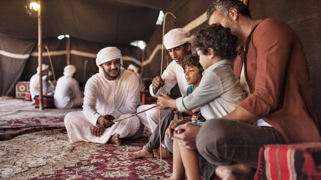 Culture Desert Tent, tourists with Emirati dancers Courtesy of Dubai Arts and Culture Authority