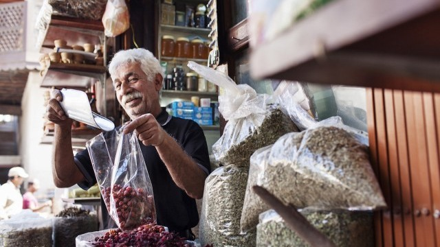 Man selling traditional spices in the souk Courtesy of Dubai Arts and Culture Authority